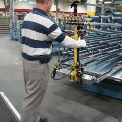 Lift assist to load panels into racks
